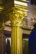column capitals  covered with gold leaf religion - stock photo