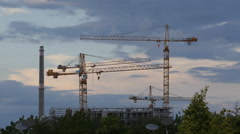 Industrial Building Under Construction Site Cranes Silhouettes Sunset Daylight Stock Footage