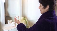 Woman taking medication - stock footage