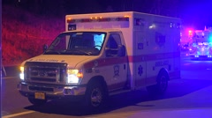 Ambulance Waiting With Emergency Lights Flashing In The Background - stock footage