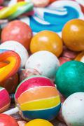 multi colored lollipop and chewing gum batskground - stock photo