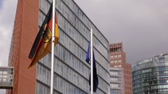 Potsdamer Platz German European Flags Office Building Apartments Complex Germany Stock Footage