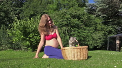 Little kitty cat jump out of wicker basket. Pregnant happy woman Stock Footage