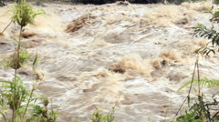 Rio Quijos in flood after heavy rainstorms in the Andes Stock Footage