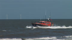 Life boats in waves on sea in rescue Stock Footage