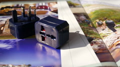 Travel Adapter on the Magazine - stock footage