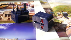 Travel Adapter on the Travel Magazine - stock footage