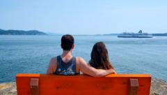 4K Man and Woman Couple Watch BC Ferry Passenger Boat Sail Past Stock Footage