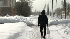 Winter street with cars and man with a back pack Stock Footage