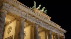 Bronze Chariot Quadriga Brandenburg Gate Columns Golden Light Late Night Berlin Stock Footage