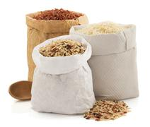 Rice in paper bag Stock Photos