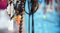 Hippies and tribal necklaces hanging in stall hawking crafts2 Stock Footage