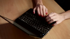 Typing on netbook computer Stock Footage