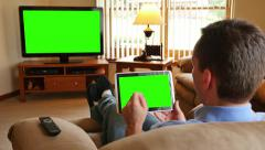 4K Man with Tablet PC Watches Television - stock footage