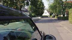 Car driving through suburban neighborhood Stock Footage