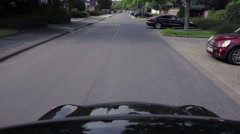 Car driving down the street shot from the roof Stock Footage