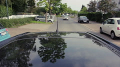 Rear view of car driving through residential area Stock Footage