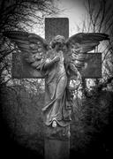 angel on a cross - stock photo