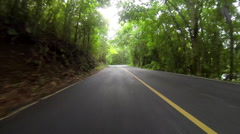 Jeep drives down hills in the USVI Stock Footage