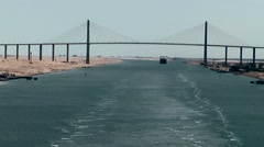 Egypt the Suez Canal 041 suspension bridge and stern wave Stock Footage
