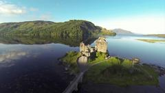 Flying over Eilean Donan Castle in Scotland on a summer day - stock footage