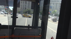Inside public transport bus, automobile stop at red color light, heavy traffic - stock footage