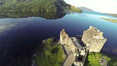 Flying over EileanDonan Castle in Scotland on a summer day Stock Footage