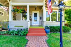 classic american house with flag - stock photo