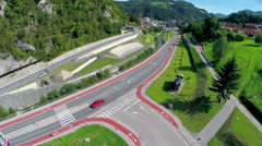Flying over new street with park and locomotive statue in Zagorje Stock Footage