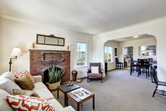 Room with brick fireplace in old american house Stock Photos