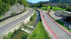 Road with river next to it aerial shot Stock Footage