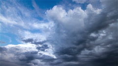 Timelapse of storm clouds travelling against a blue sky - stock footage