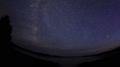 Starry sky over the lake Moiseevskoe, Valdaysky district, Novgorod region Stock Footage