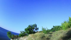 Starry sky over the reservoir in Kremenchuk. Mountain Piviha. Kremenchuk Stock Footage