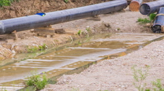 Gas line building pipes panning over Stock Footage