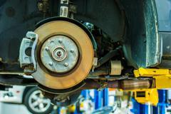 Brakes repair auto service. modern car brakes servicing. car maintenance. aut Stock Photos