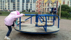 Child riding a carousel in the yard Stock Footage