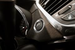 Modern car ignition button closeup, modern car driving. Stock Photos