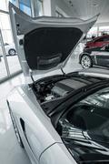 Modern car dealer showroom vertical photo. cars exposition. sporty luxury car Kuvituskuvat