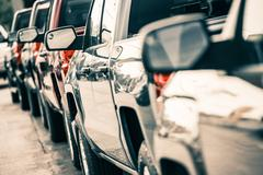 Cars traffic closeup. urban transportation concept. pickup trucks line. Stock Photos