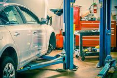 Car servicing station with car lift. auto service interior. Stock Photos