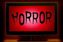 TV with engraved the word horror on screen Stock Photos