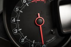 Modern gas fuel car tachometer rpm meter closeup Stock Photos