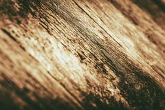 wood closeup with shallow depth of field. golden brown wood background. - stock photo