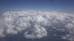Fly over white fluffy clouds 4K - stock footage