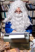 Stock Photo of bearded author working on a old typewriter