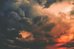 Reddish dark storm cloud. stormy weather photo background. Stock Photos