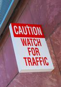 Caution, watch for traffic wall sign. warning sign Stock Photos