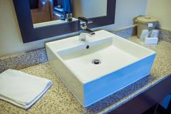 Hotel bathroom square style sink. hotel interior. Stock Photos