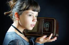 Girl With Old Radio - stock photo